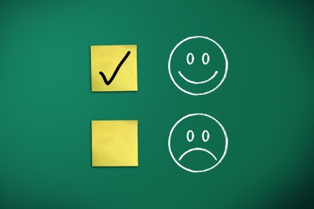 positive feedback rapresentated by emoticons on green chalk board Stock Photo - 17322226