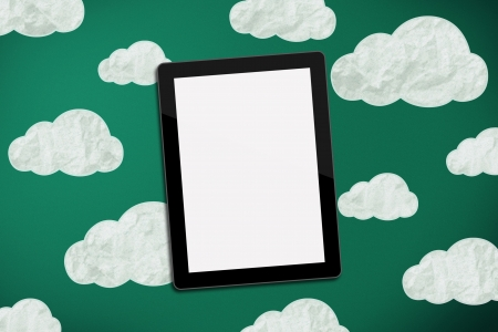tablet on green chalk board with clouds Stock Photo - 17322216