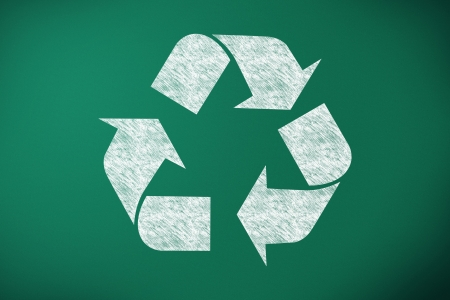 recycling symbol designed on green chalk board Stock Photo