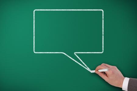 Speech Bubble on blackboard and hand design it Stock Photo