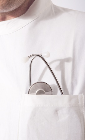 mature doctor with stethoscope in the pocket