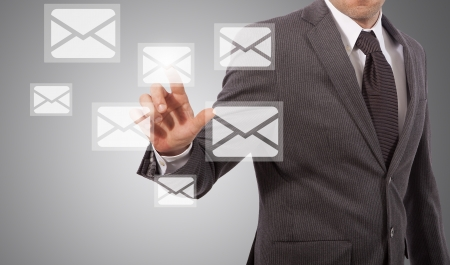 business man open email touching icon on screen, grey background Stock Photo - 17961921