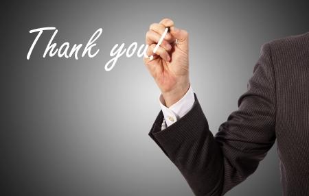 businessman write thank you on glass