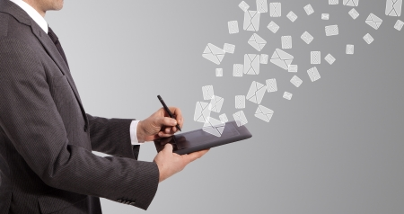 business man write mail on tablet, grey background photo