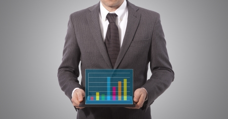 business man with showing graph on tablet Stock Photo - 17961835