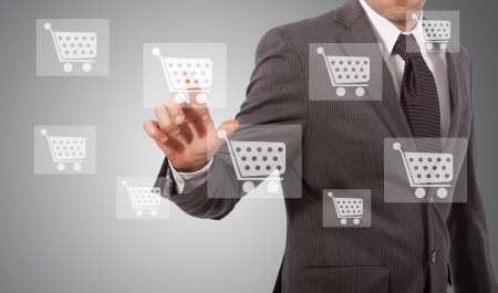 business man touching ecommerce icon on screen