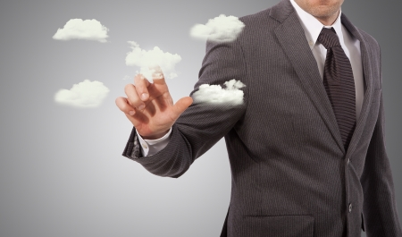 business man touching cloud structure, grey background Stock Photo - 18650104