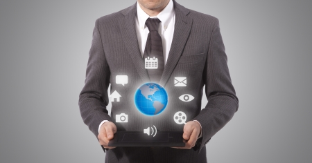 business man with touch tablet in hands, grey background  world map  Stock Photo - 18650053