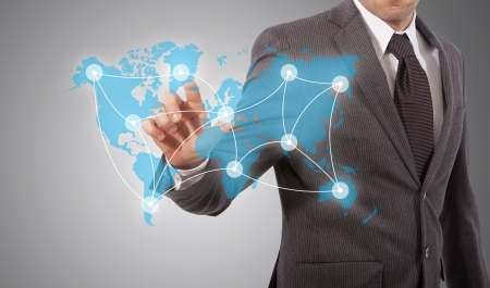 business man touching world map with social network structure, grey background