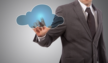 business man touching cloud on screen, grey background Stock Photo - 18650111