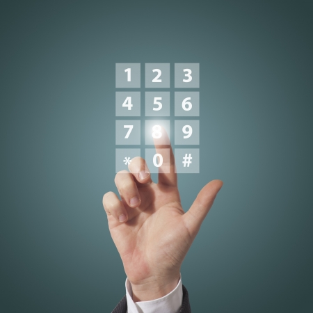 business man compose telephone number on screen, blue background