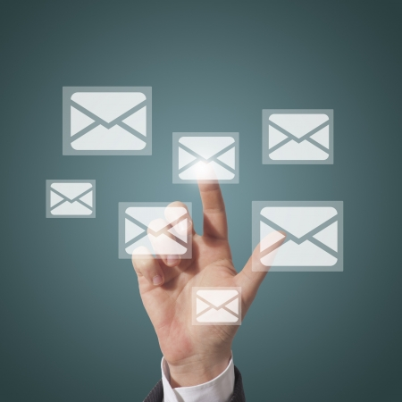 business man open email touching icon on screen, blue background