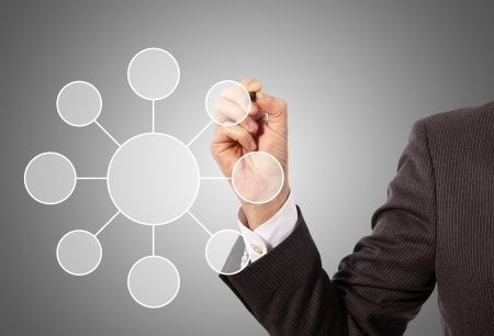 Male hand drawing social network structure, grey background Stock Photo