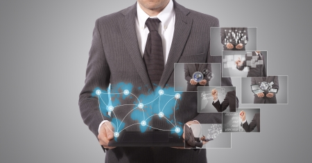 edu: business man holding a tablet, grey background  world map from www lib utexas edu Stock Photo