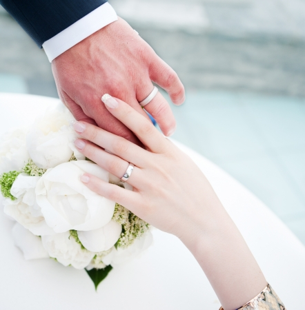 hands of bridal couple with wedding rings Stock Photo