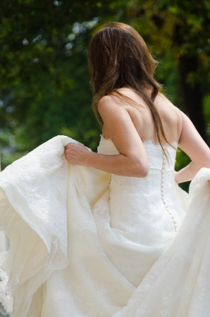 cross ties: bride with her white dress in the wedding day