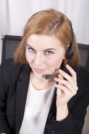 Closeup of customer service executive smiling and looking