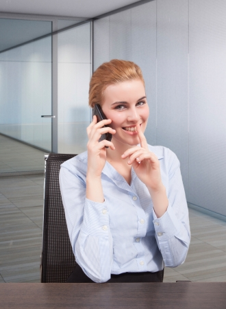 Businesswoman on phone gesturing quite during calling
