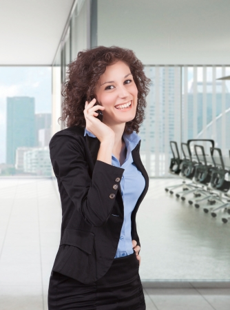 businesswoman take a call with cellphone in the office