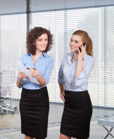 young businesswomen are meeting in a commercial business lobby Stock Photo
