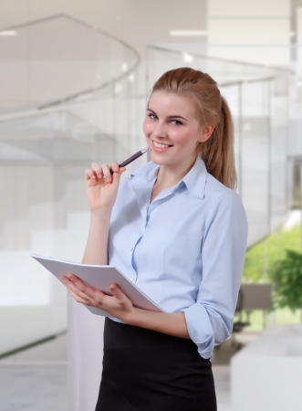 Businesswoman organizing her notes in office photo