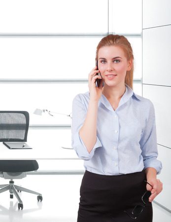businesswoman using cellphone in the office Stock Photo