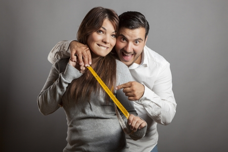 The boldness couple shows the sex length with a tape measure photo