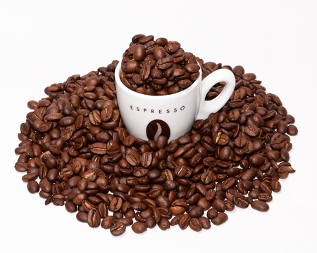 espresso cup and coffee beans grouped together on white background. Stock Photo - 11990712