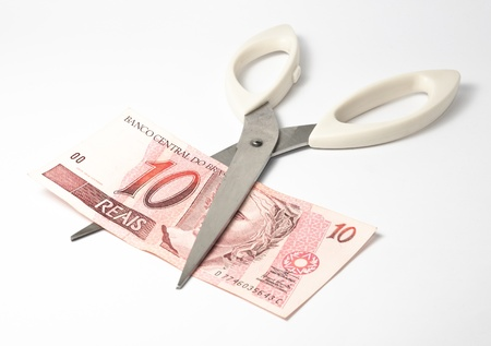 scissors cutting ten brazilian reais banknote Stock Photo - 11990507