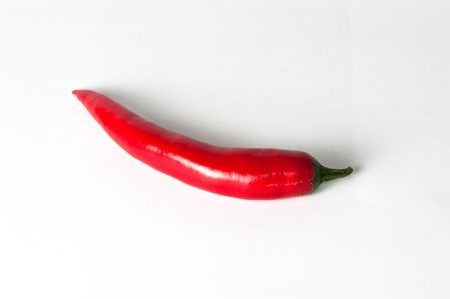 intense flavor: Chili pepper on a white background.