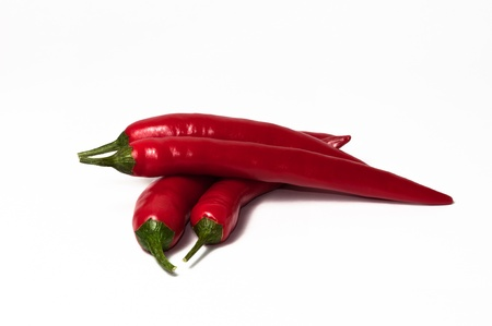 intense flavor: two pair chili peppers on a white background.