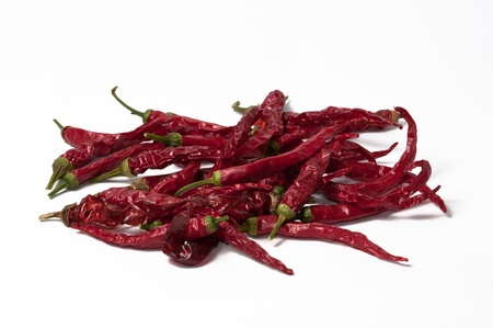 dehydrate: Several dehydrate cayenne peppers on a white background.