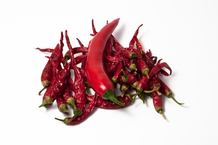 dehydrate: one dehydrate and several chili peppers on a white background. Stock Photo