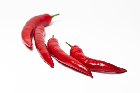 Hot chili peppers form a hot chili shape. Stock Photo - 11990332