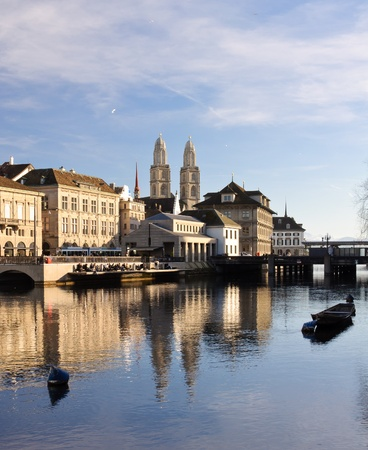 View of the Zurich historical city center reflecting into the river Limmat photo
