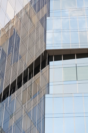 Detail of a blue mirror glass tower. photo