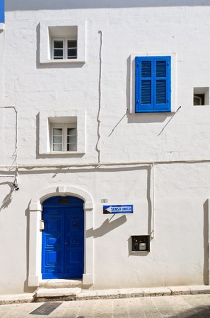White house with blue shutter and door; Typical of the south of italy. photo