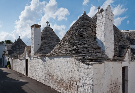 Stone hand made ancient houses called 'Trulli' in Apulia, Italy. photo