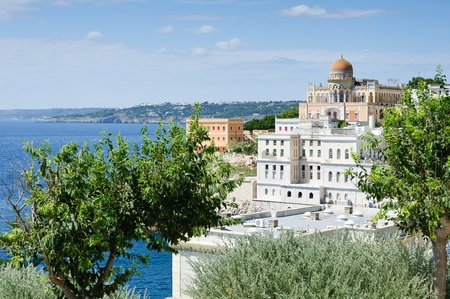 moresque: View of a eastern style villa and some white houses on the southern coast of Italy. Santa Cesarea Terme. Stock Photo