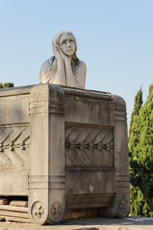 Tomb decorated with statues and sculptures in the monumental cemetery of Montjuic - Barcelona, Spain  photo
