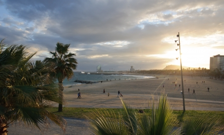 Barceloneta and Port sports competition beaches at sunset in winter