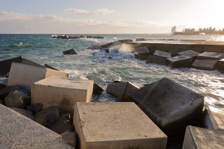 Breakwater rocks on the Barcelona coast  Spain  photo