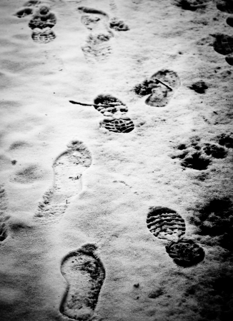 Footprints in the snow  Black and white picture