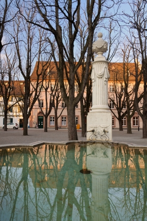 munster: Fountain reflection in Muensterplatz  Munster square  in Basel, Switzerland  Stock Photo