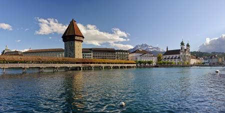 Chapel bridge and the Jesuit church  Lucerne, Switzerland photo