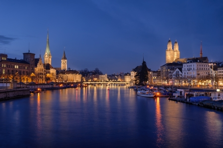 Zurich city center viewed from the river by night  Switzerland
