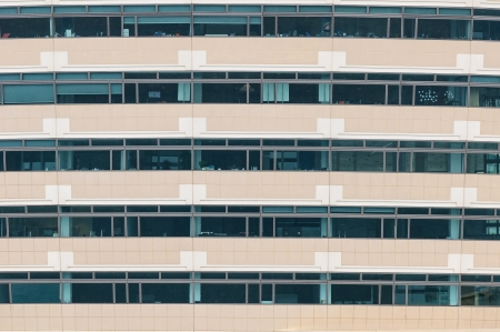 Office building facade; a repeating pattern of windows