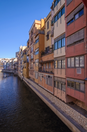 Colorful houses along the Onyar river in Girona, Catalonia, Spain