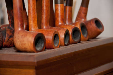 pipe smoking: Series of briar pipes for smoking old-fashioned Stock Photo