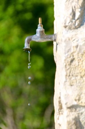Water preservation, old faucet Standard-Bild